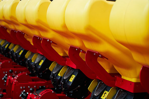 Precision planters used in the agriculture industry use injection molded plastic parts
